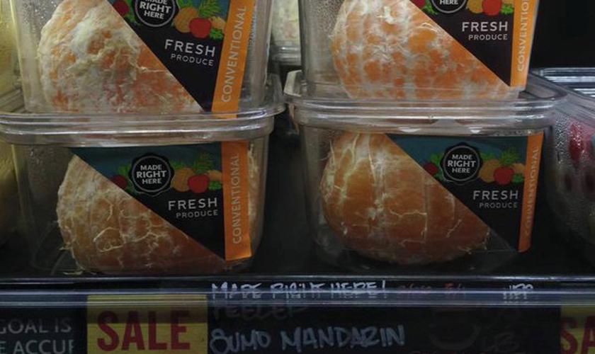 Neu-verpackte Orangen